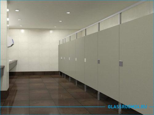 Туалетные кабинки в офисном здании серого цвета